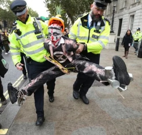 Nice to see you: Clown protester caught in mid air