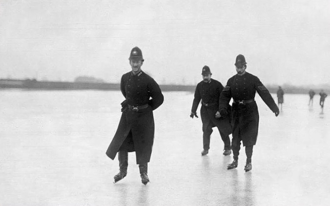 MPS officers on ice skates on the frozen River Thames circa 1900.