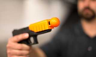 Bullet-catching device turns ordinary frearm into one-shot less-lethal weapon