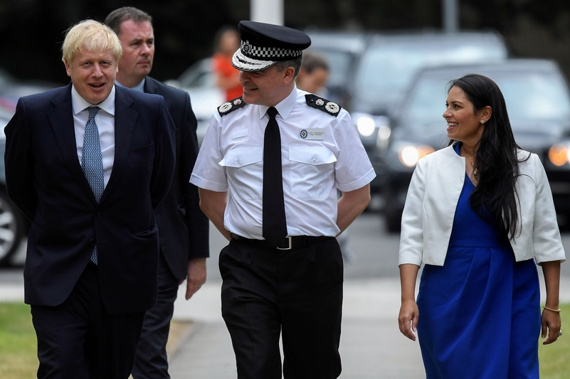 Walk and talk: Boris Johnson with West Midlands chief Dave Thompson and Home Secretary Priti Patel