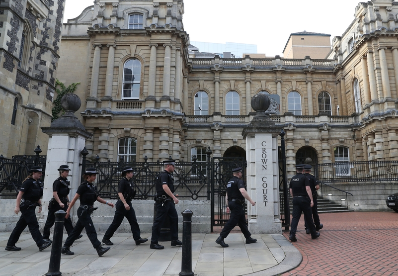 Police presence: Officers outside Reading Crown Court
