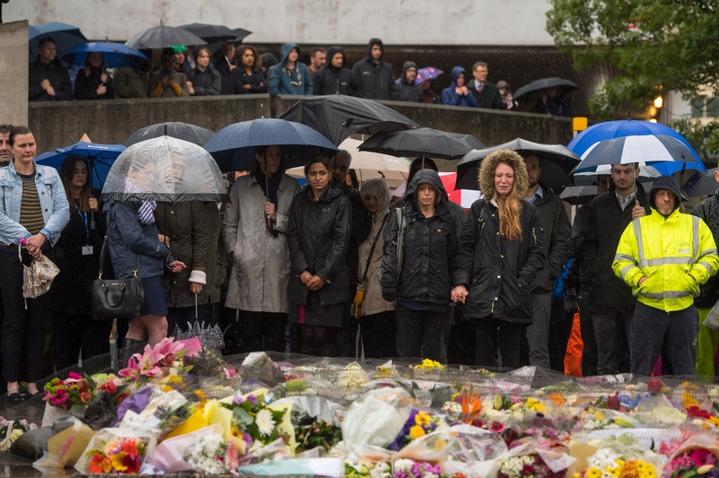 Mourners and members of the public held a vigil at the scene of the attack yesterday (Credit: PA)