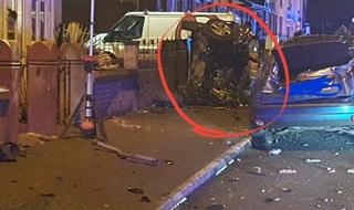 The driver lost control before colliding with parked cars and a wall