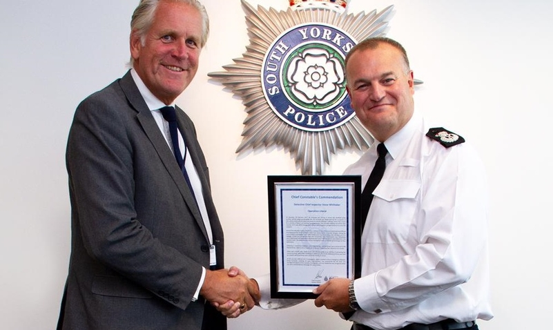 Commendation: Retiring DCI Steve Whittaker, left, with South Yorkshire Chief Constable Stephen Watson