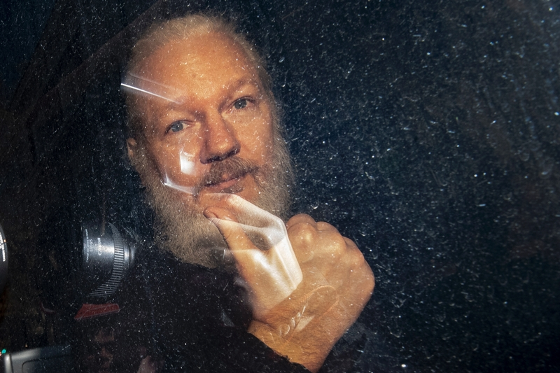 Out and back in: Julian Assange leaving the Ecuadorian embassy