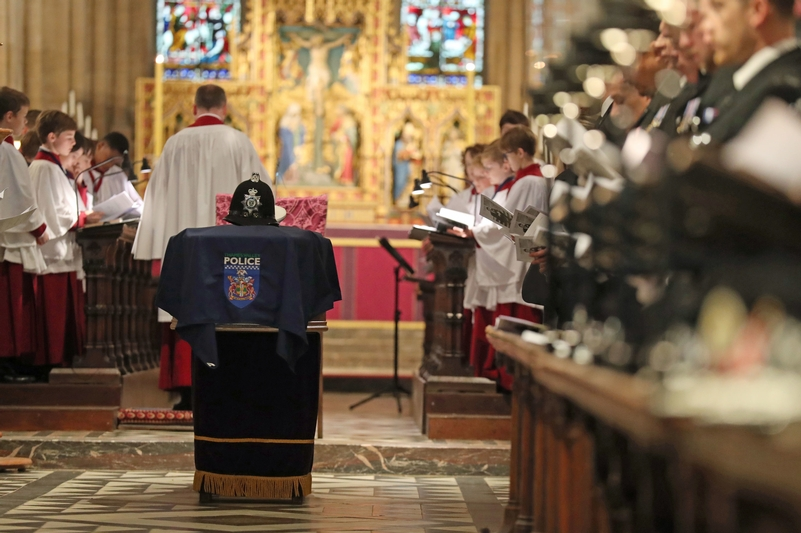 With one voice: Paying tribute in song to PC Andrew Harper, his service helmet resting on his coffin at Church Church cathedral, Oxford