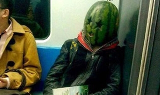 Man in watermelon mask scares passengers