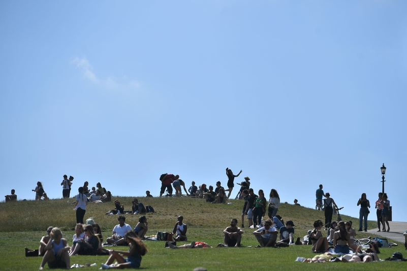 People relax on Primrose Hill, London