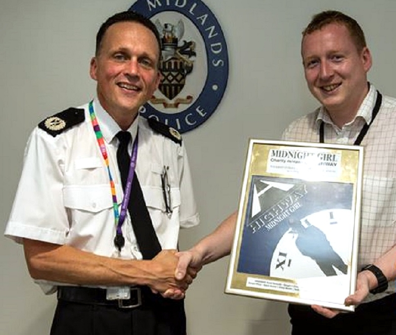 This one's for you: PC Will Salt, right, present a personal copy of the charity single Midnight Girl to ACC Chris Johnson