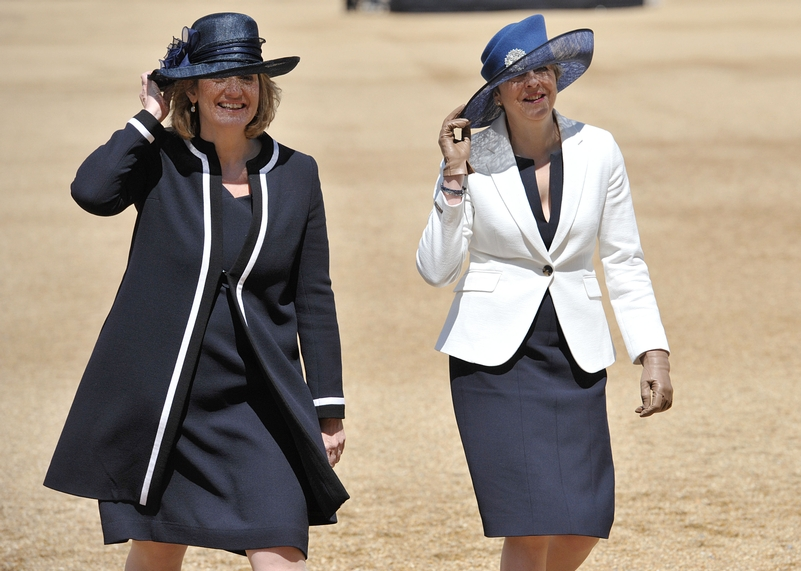 Prime Minister Theresa May and Home Secretary Amber Rudd (left) hold onto their hats as they depart following a welcome for King Felipe VI and Letizia of Spain. Photo: Nick Ansell/PA Wire
