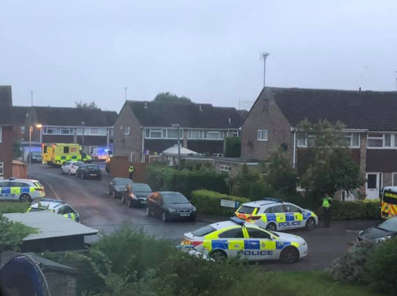Stand-off: Picture taken with permission from the twitter feed of Claire Louise Brookes of police and emergency personnel near the Dockle Farmhouse and New Inn pubs in Swindon