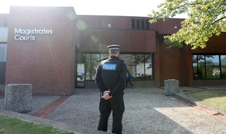 Lone watch: An officer outside Reading Magistrates' Court