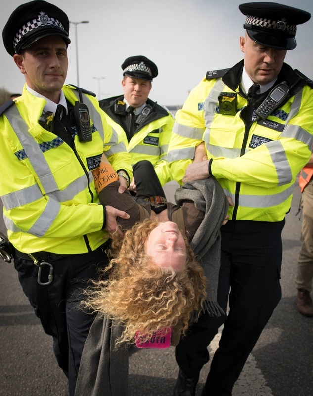 Face of protest: A climate change supporter removed from Waterloo Bridge, London