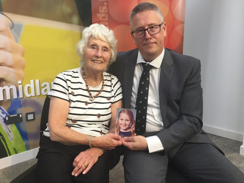 Never forgotten: Helen Bailey's mother, Margaret, and brother, Adrian, holding a picture of the girl whose body was found in woodland in August 1975