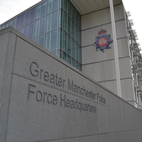 Man jailed for spitting blood at Greater Manchester officers