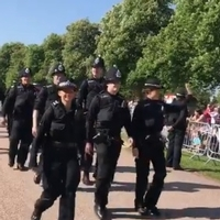 Police officers applauded by Royal Wedding crowd