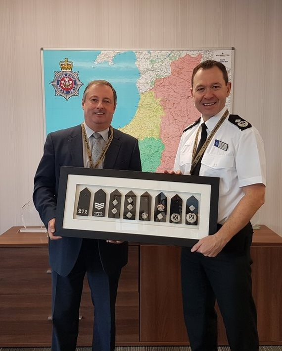 Start to finish: DCC Darren Davies, right, receiving his retirement gift from CC Mark Collins