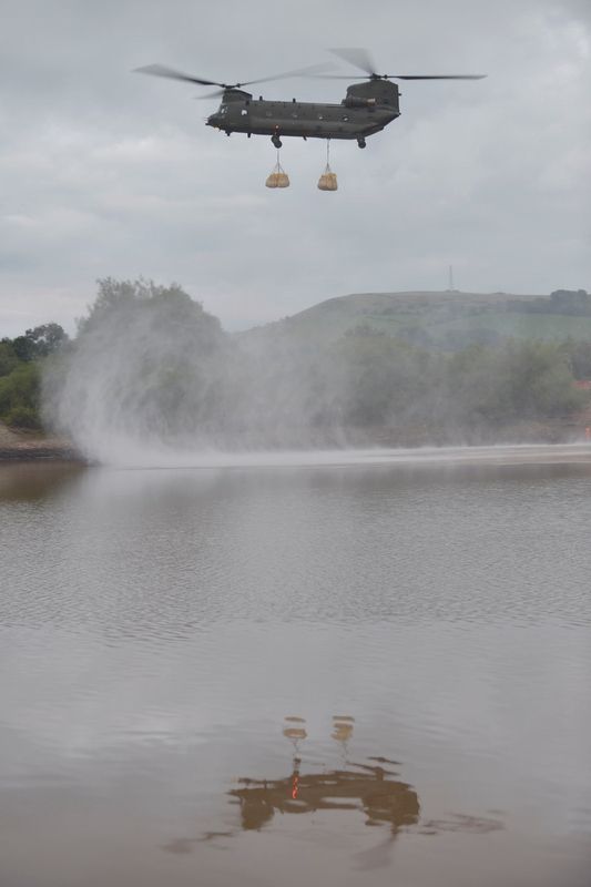 Vital support: An RAF Chinook hovers over the damaged dam