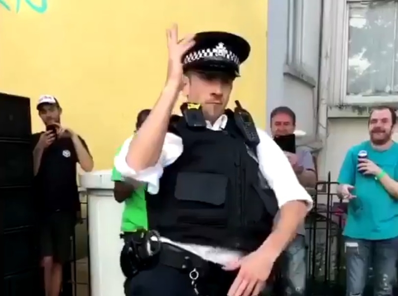 The crowd cheered the officer as he cut his moves by the sound system (Credit: Twitter)