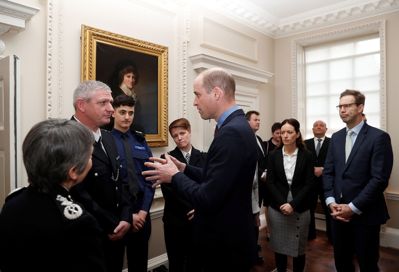 The Duke of Cambridge, talks with officers including PC Shaun Cartright (second left), who collected the Outstanding Bravery Award posthumously awarded to PC Keith Palmer (PA)
