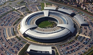 GCHQ's 'doughnut' is one of the sites guarded by the force. Credit below