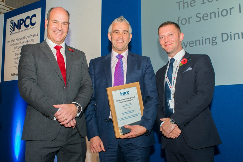 National recognition: DCI David Swift-Rollinson, centre, with Cdr Stuart Cundy, left, and Darren Bradley