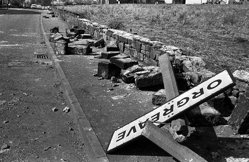 Every picture tells a story: A twisted sign, felled concrete posts and a broken wall recall the violence outside a coking plant in Orgreave, South Yorkshire in June 1984