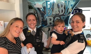 Rebecca and baby Bobby with PC Holly Foran and PC Nicola Devlin with Bobby's sister Marnie