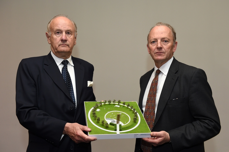 Lord John Stevens and Sir High Orde with a model of what the memorial will look like. Photo: Joe Giddens/PA Wire
