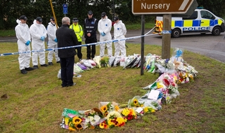 In silent tribute: Officers stand at the scene where Pc Andrrew Harper died