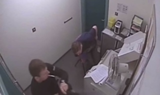 Video: Drunk-driver falls over and headbutts wall
