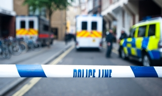 Armed officers shoot man 'carrying firearms'