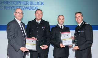 Officers honoured for saving armed burning woman