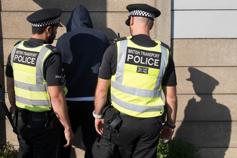 Stop and search being carried out by BTP officers. Photo: PA Wire