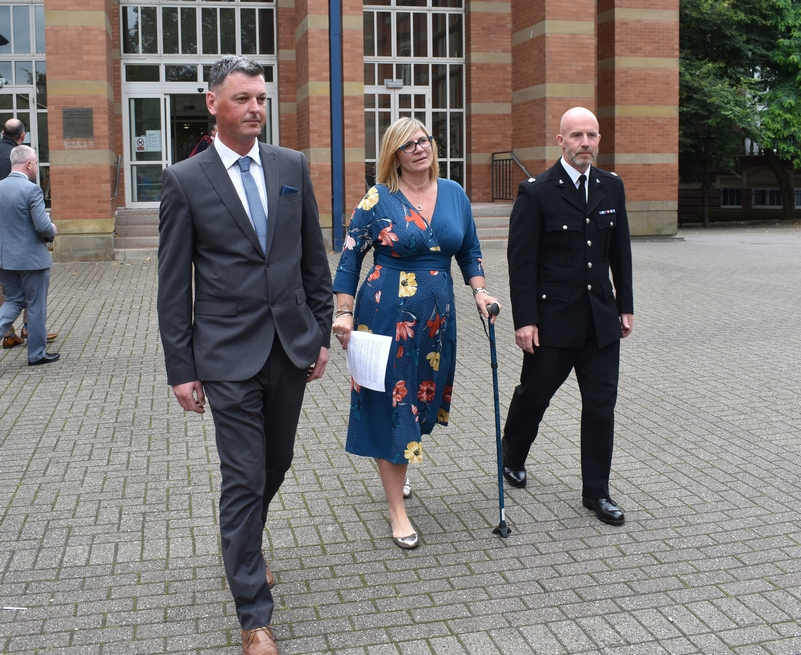 Justice: PC Bond, centre, leaving court with PC Mullins, left, and Supt Carl Ratcliffe, right, after her attacker was jailed for 12 years