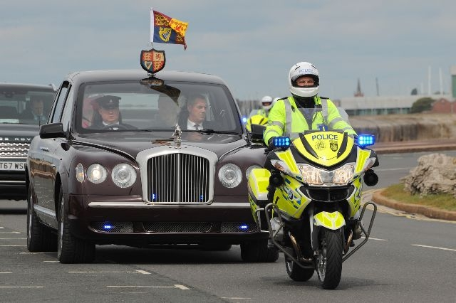 Royal rideout: Sgt Bob Heard leads the Queen