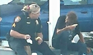Touching moment police officer buys food for homeless man