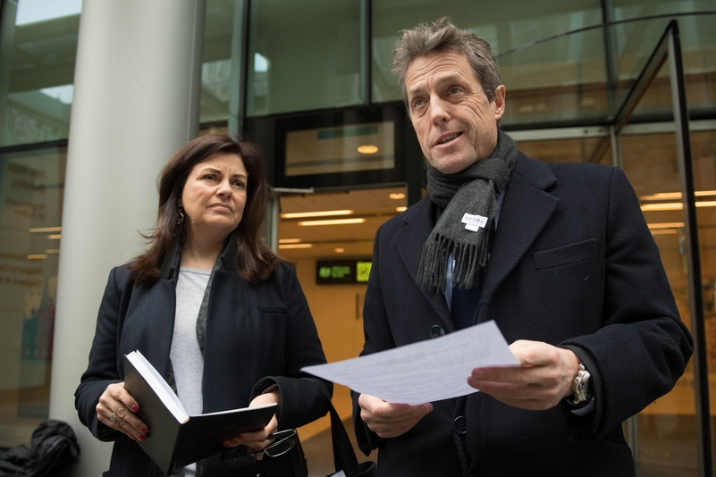 Actor Hugh Grant and Crimewatch presenter Jacqui Hames outside the Rolls Building in London. They both settled cases against media organisations on Monday. Photo: Stefan Rousseau/PA Wire