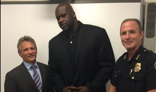 Basketball star Shaquille O'Neal turns police officer