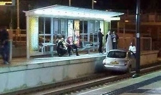 Arrest after car ends up on tram tracks