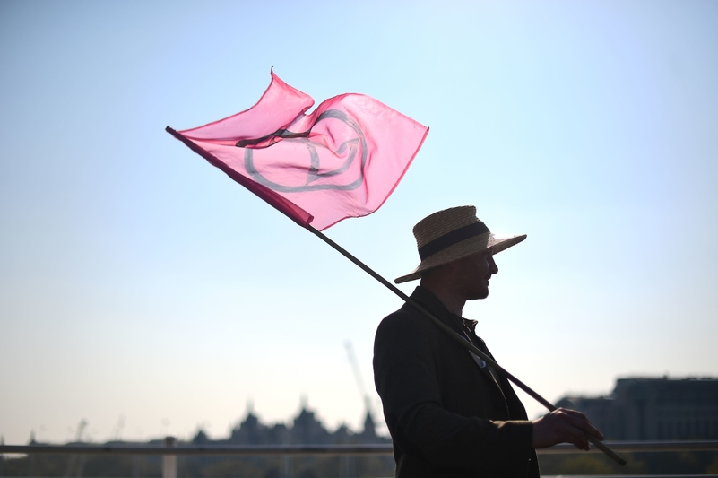 Flying the flag: An Extinction Rebellion protester on Waterloo Bridge