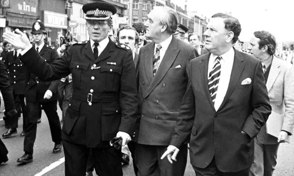 Taking to the streets: Sir David McNee with Home Secretary Willie Whitelaw in riot-torn Brixton