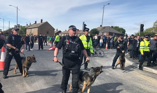 Police separate demonstrators in Bootle, Merseyside, after Tommy Robinson leaves following an election campaign event.
