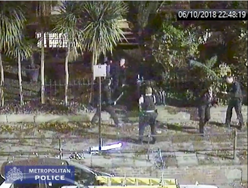 Under attack: CCTV shows knife-wielding assailant head for officers