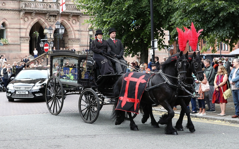 DC McIver's coffin was taken to the service in a horse-drawn carriage