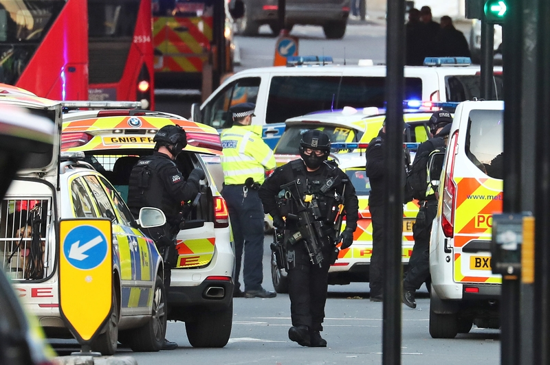 Armed officers arrive at the scene of the London Bridge attack