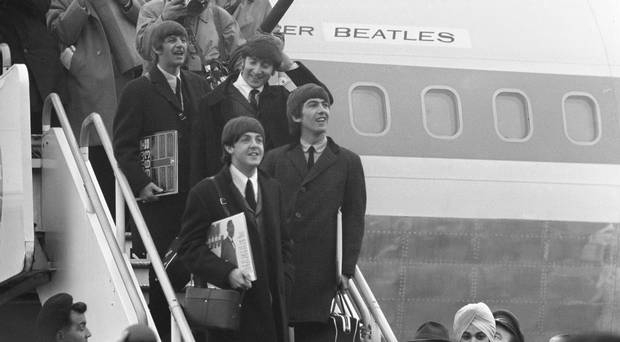 Returning heroes: The Beatles back on British soil after their trip conquering the US