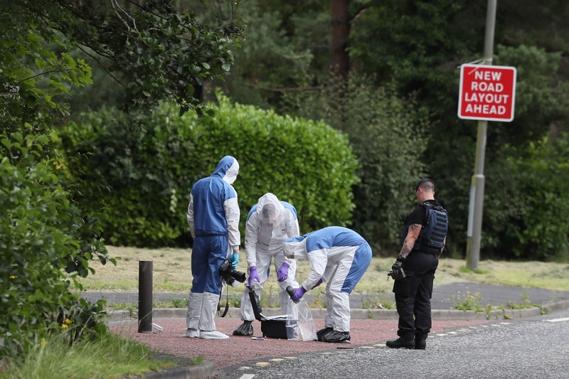 Checkpoint: An ammunition technical officer and forensic officers in Craigavon, County Armagh after an explosive device used by dissident republicans in a failed bid to kill police officers was discovered