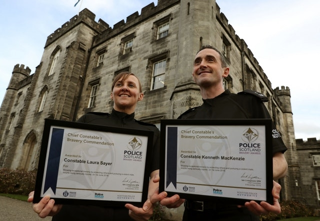 Putting on a brave face: Smiles from award-winning PCs Laura Sayer and Kenneth McKenzie
