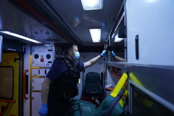A Met Police officer in the back of an ambulance